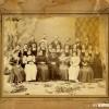 Ученичките при Солунската женска гимназија 1895-1896 г. со учителите Георги Пенев, Анастас Наумов, Бано Кушев, Атанас Бадев (5ти во горниот ред)