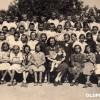 """1949/50: Ученици од IV одделение при ОУ """"Свети Кирил и Методиј"""" со учителката Спасија."""