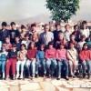 """1989/90: Ученици од IV одделение од ОУ """"Гоце Делчев"""" со наставникот Серафим Дукоски."""